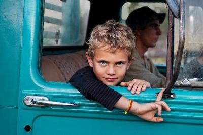 _DSC4677, Lavazza, Lambari, Brazil, 08/2010, BRAZIL-10106NF3. A young boy looks out the window of a truck.final print_MonzaPORTRAITS_APPretouched_Sonny Fabbri 11/2014