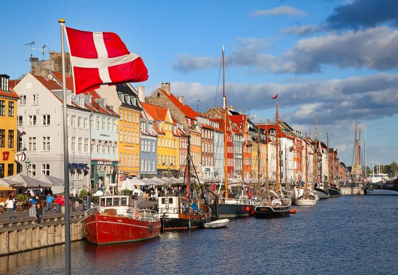 COPENHAGEN, DENMARK - AUGUST 25: unidentified people in open cafes of the famous Nyhavn promenade on