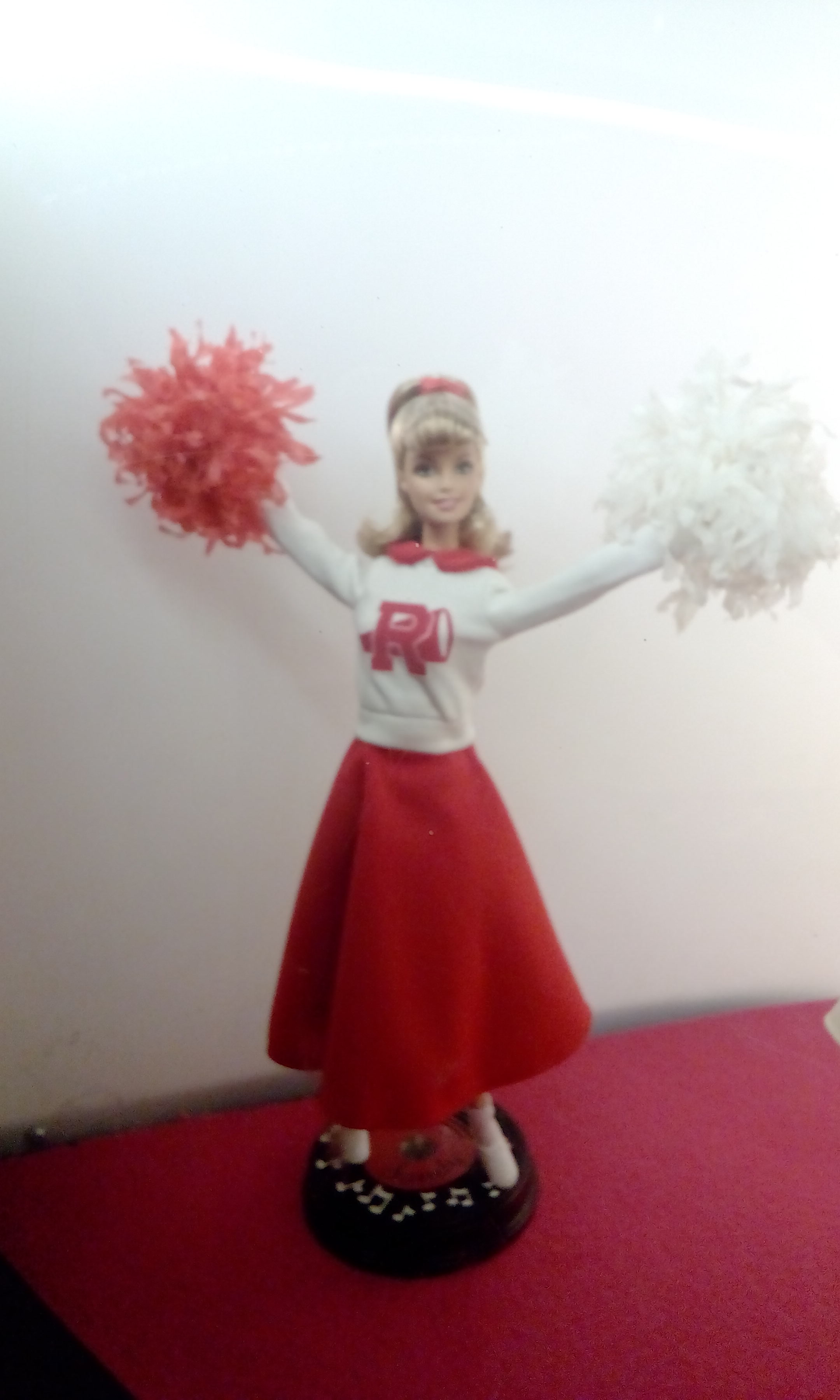 Grease, Sandy doll