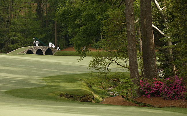 Apr 10, 2015; Augusta, GA, USA; Phil Mickelson leads his group across the Hogan Bridge on the 13th green during the second round of The Masters golf tournament at Augusta National Golf Club. Mandatory Credit: Rob Schumacher-USA TODAY Sports