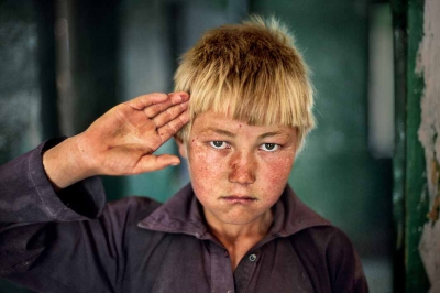 00170_01, Afghanistan, 2006, AFGHN-12947. A young boy in Afghanistan.NN11470892IG OLD: The hands which beckon,embrace, soothe, and comfort usBid us farewell - Kaye EarleJuly 30, 2015IG: I photographed this young Hazara boy in the Bamiyan Province of Afghanistan. The Hazaras, residents of an isolated region in Afghanistan's central highlands known as Hazarajat. Hazaras make up about 20% of the population of the country.Retouched_Sonny Fabbri, Kylie Wright, Sam Wallander 10/2/2018